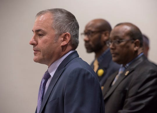 Mayor Bill Wild speaks about the goals of the program. At right, John D. Hearn, pastor of Christian Faith Ministries and the western Wayne County NAACP, and the Rev. John E. Duckworth of Gethsemane Missionary Baptist Church. Both spoke in favor of the body cameras and dialogue with city officials.