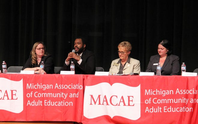 Candidates answer questions from adult education students during a forum held Oct. 23 at Novi Middle School.