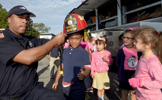 Park Vista Elementary students get to try on turnout gear used by the Opelousas Fire Department. Members of the OFD visited the school recently in observance of National Fire Prevention Week.