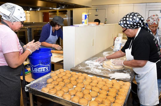 Volunteer chefs busy baking sweet potato pies for the upcoming Holy Ghost Creole Festival to be held November 2-4.