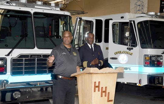 Mayor Reggie Tatum and Opelousas Fire Chief Charles Mason addresss the audience at Saturday's blessing of the three new fire trucks by Rev. Rofinus Jas, Holy Ghost Catholic Church pastor.