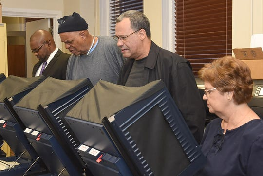 St. Landry Parish residents cast their vote on the first day of early voting at the St. Landry Parish Courthouse.