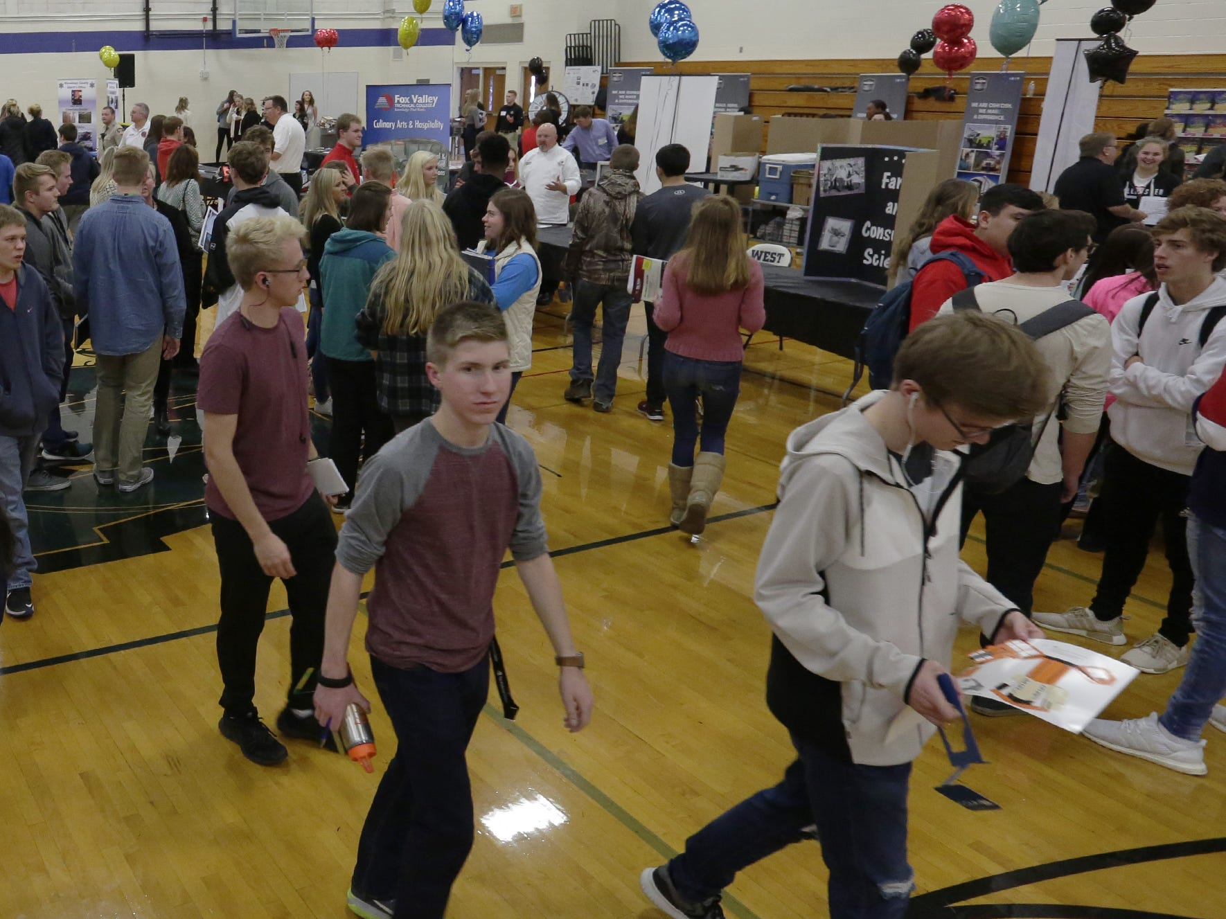 About 1,000 students from Oshkosh and Omro middle and high schools participate Tuesday, Oct. 23, 2018, in the Oshkosh Chamber of Commerce's Career Exploration Fair at Oshkosh West High School. This year's fair expanded to high school students, thanks to a $5,000 grant from AT&T.