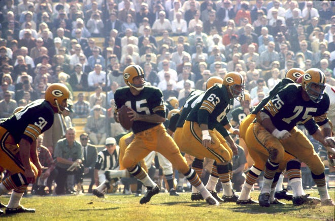 Green Bay Packers Hall of Fame quarterback Bart Starr (15) drops back to pass during Super Bowl I, a 35-10 victory over the Kansas City Chiefs on January 15, 1967, at the Los Angeles Memorial Coliseum in Los Angeles, California.