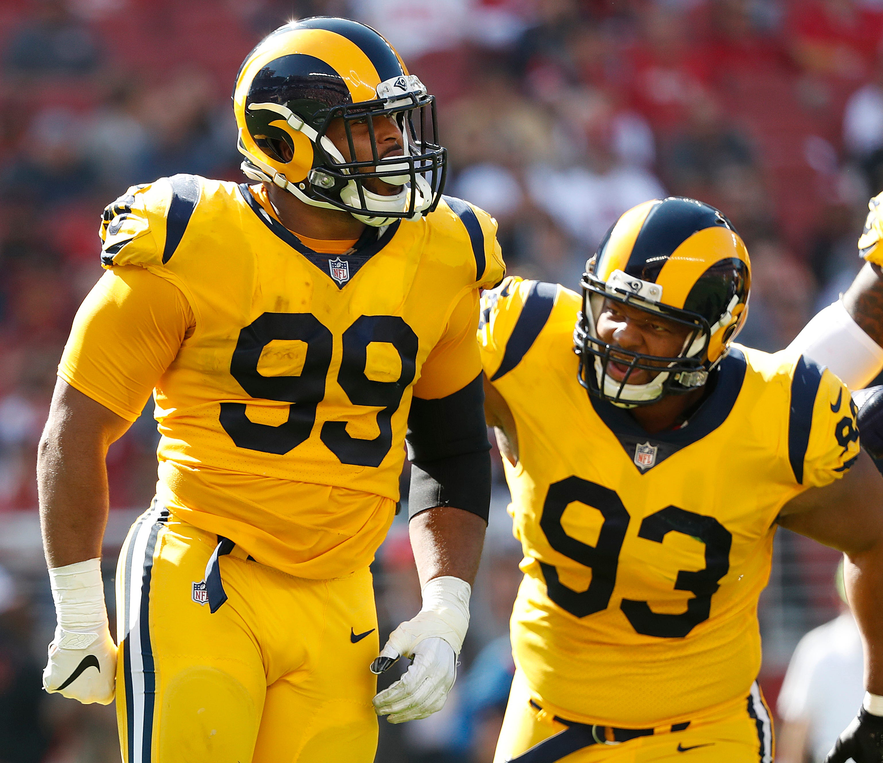 Los Angeles Rams defensive tackle Aaron Donald (99) celebrates with defensive tackle Ndamukong Suh (93) during the first half of an NFL football game against the San Francisco 49ers in Santa Clara, Calif., Sunday, Oct. 21, 2018. (AP Photo/Tony Avelar)