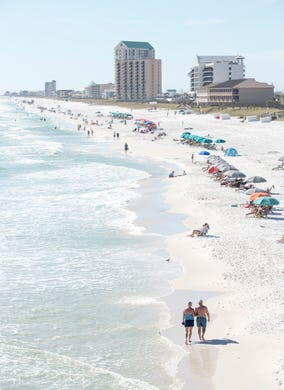 People Enjoy The Beautiful Day At Navarre Beach On Wednesday October 24 2018
