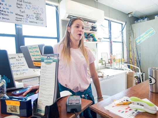Navarre Beach Fishing Pier attendant Carly Haytack discusses the red tide situation in Navarre on Wednesday, October 24, 2018.  Haytack explained that people were feeling effects of red tide a couple of weeks ago, but not in recent days.