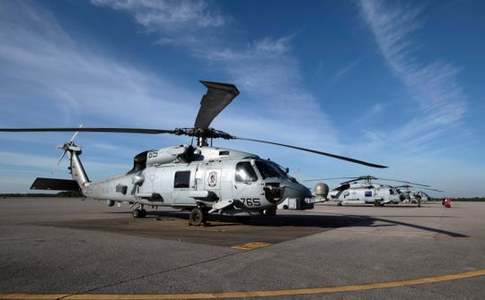 Various types of helicopters line the tarmac Wednesday at Whiting Field in Milton.