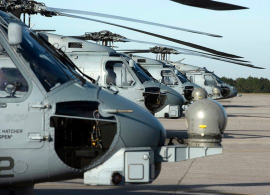 A variety of helicopters line the tarmac at Whiting Field in Milton on Oct. 24. Whiting welcomed flight crews from around fleet to the military installation to give flight students a close-up look at the aircraft.