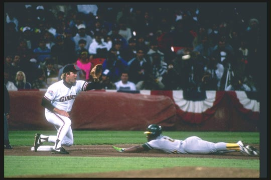 Oakland's Rickey Henderson holds MLB records for steals and runs in a career, among others.