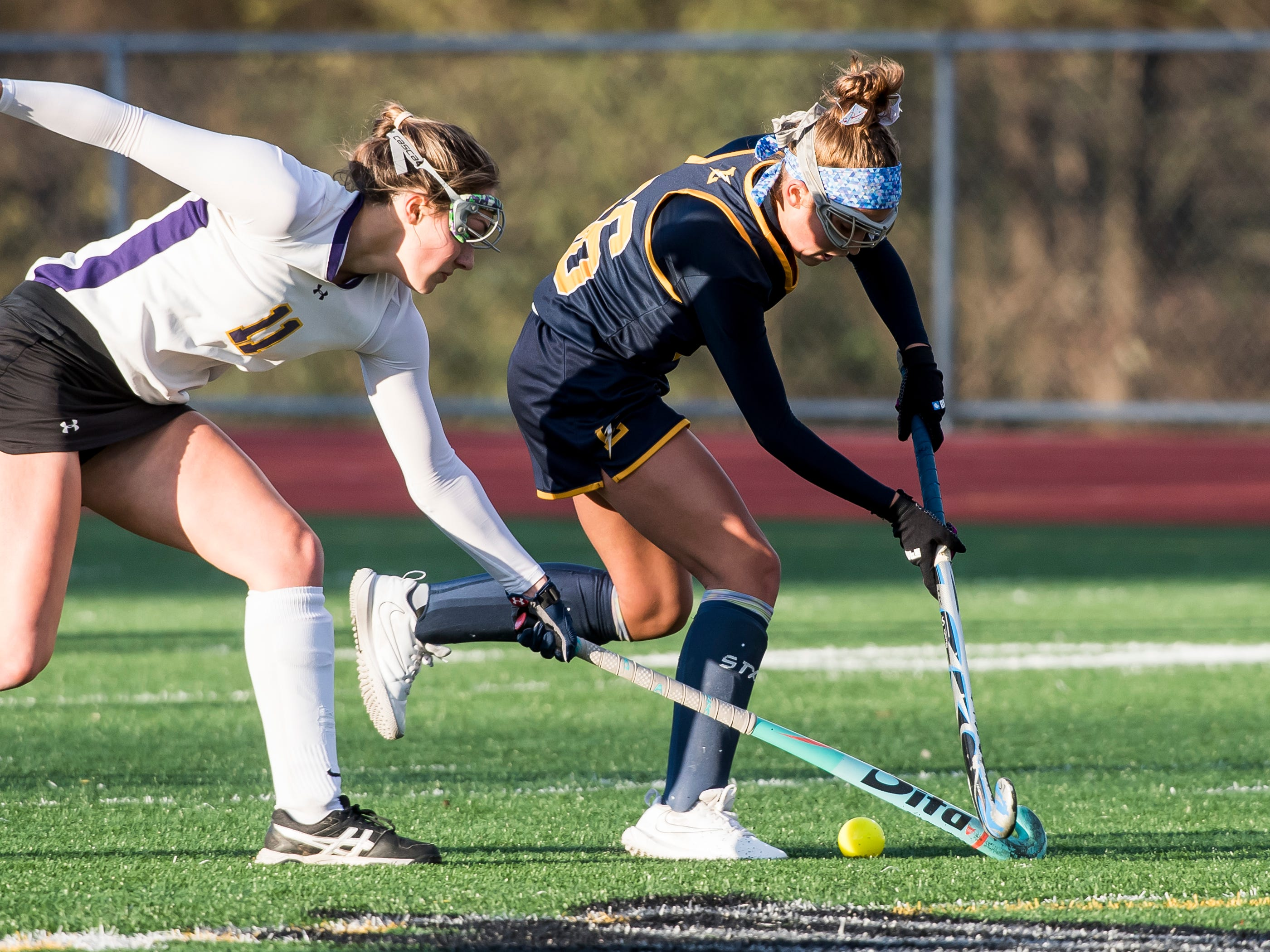 Littlestown's Carter Clabaugh and Boiling Springs' Allie Ball battle for the ball during a PIAA District III first round game at Bermudian Springs High School on Wednesday, October 24, 2018. The Bolts fell 2-0.