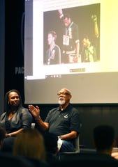 Bronze-medal track winner John Carlos speaks to students during a forum at ASU in Tempe, Ariz. October 23, 2018. He raised his fist on the podium at the 1968 Olympics, causing political controversy. At left is panelist Gina Hemphill-Strachan.
