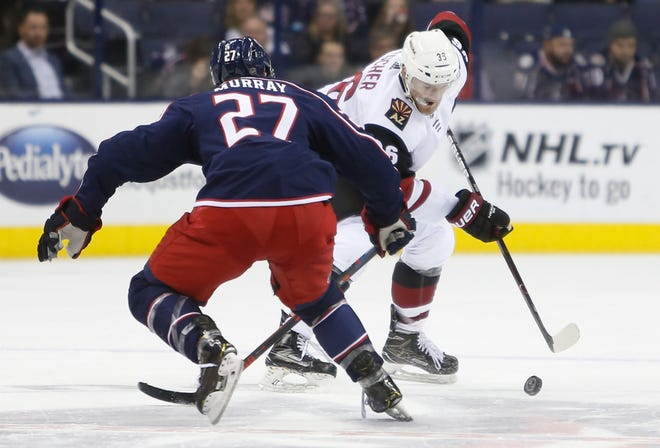 Arizona Coyotes' Christian Fischer, right, carries the puck up ice against Columbus Blue Jackets' Ryan Murray during the third period of an NHL hockey game Tuesday, Oct. 23, 2018, in Columbus, Ohio. The Coyotes beat the Blue Jackets 4-1.