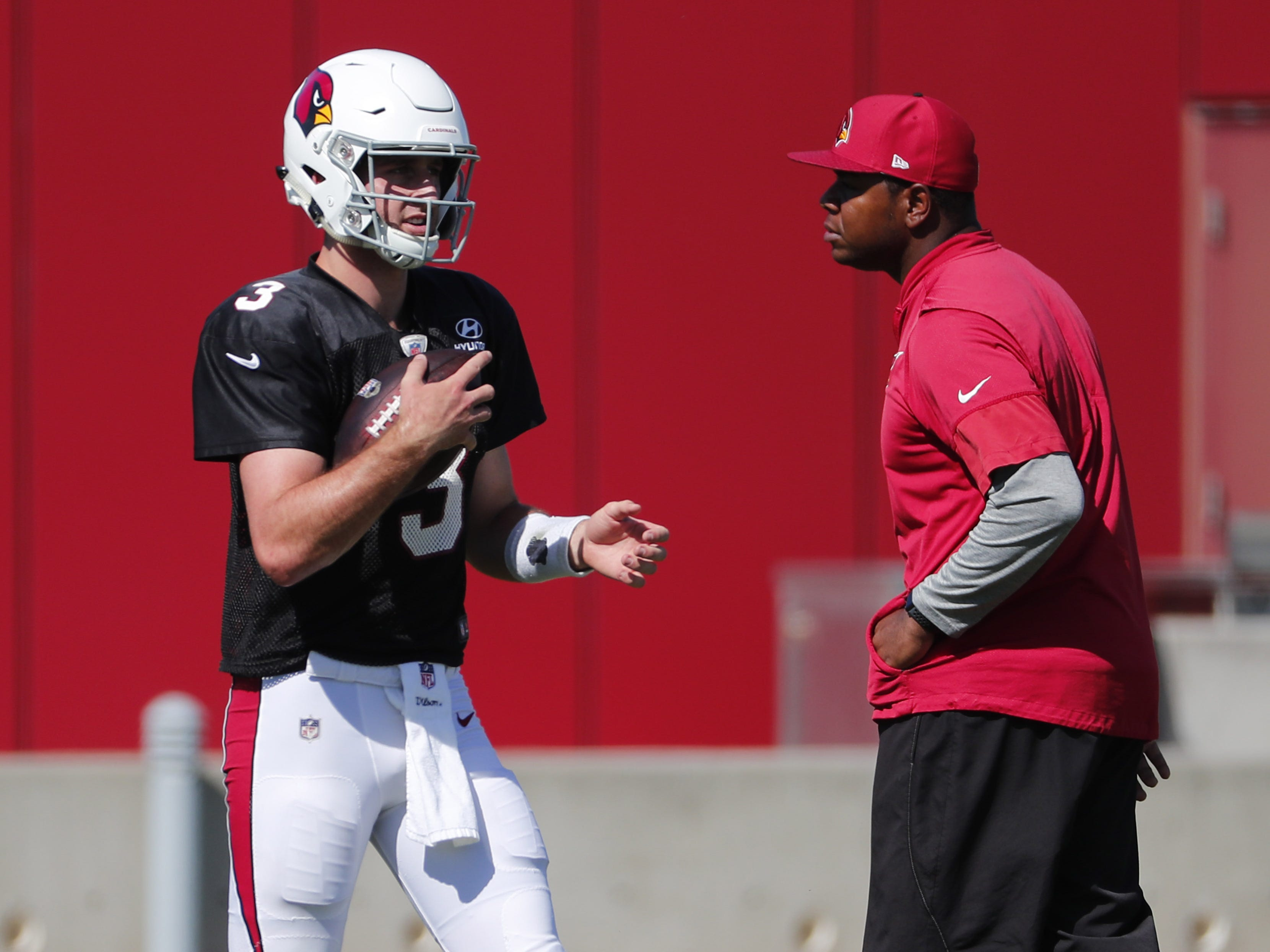 Arizona Cardinals quarterback Josh Rosen (3) and offensive coordinator Byron Leftwich walk between drills during practice in Tempe, Ariz. October 24, 2018.
