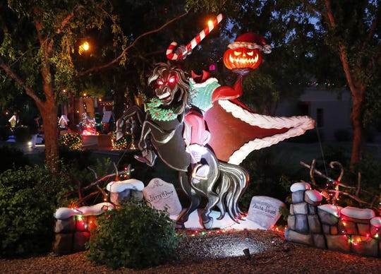 Jessica and Francis Brown host an elaborate and professionally done Halloween/Christmas display in Tempe, Ariz. October 23, 2018. The headless horseman was added this year.