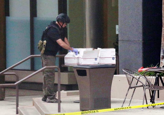 A San Diego bomb squad looks over a  package in the city's downtown on Oct. 24, 2018. Nothing suspicious was found inside.
