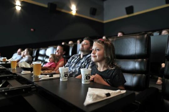 Movie-goers can reserve seats in advance at Flix Brewhouse.