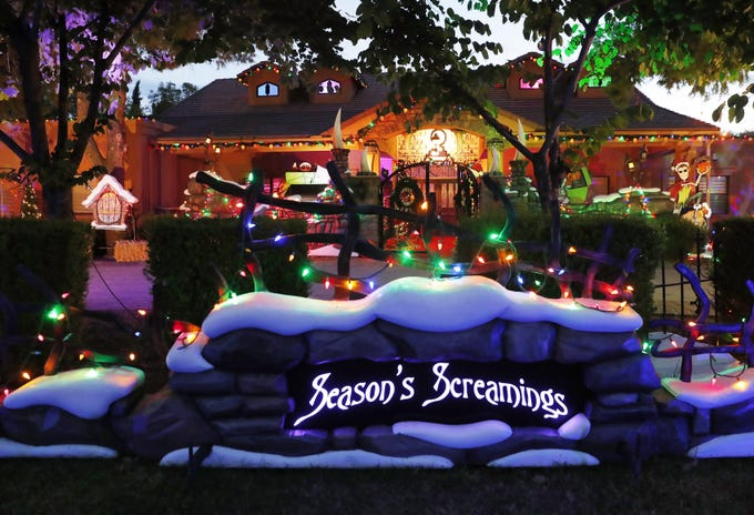 Jessica and Francis Brown host an elaborate and professionally done Halloween/Christmas display in Tempe, Ariz. October 23, 2018.