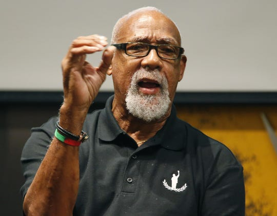 Bronze-medal track winner John Carlos speaks to students during a forum at ASU in Tempe, Ariz. October 23, 2018. He raised his fist on the podium at the 1968 Olympics, causing political controversy.
