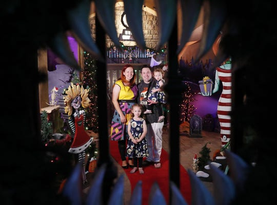 Jessica and Francis Brown, with their kids Samantha (left), 5, and Quinn, 1, host an elaborate and professionally done Halloween/Christmas display in Tempe, Ariz. October 23, 2018.