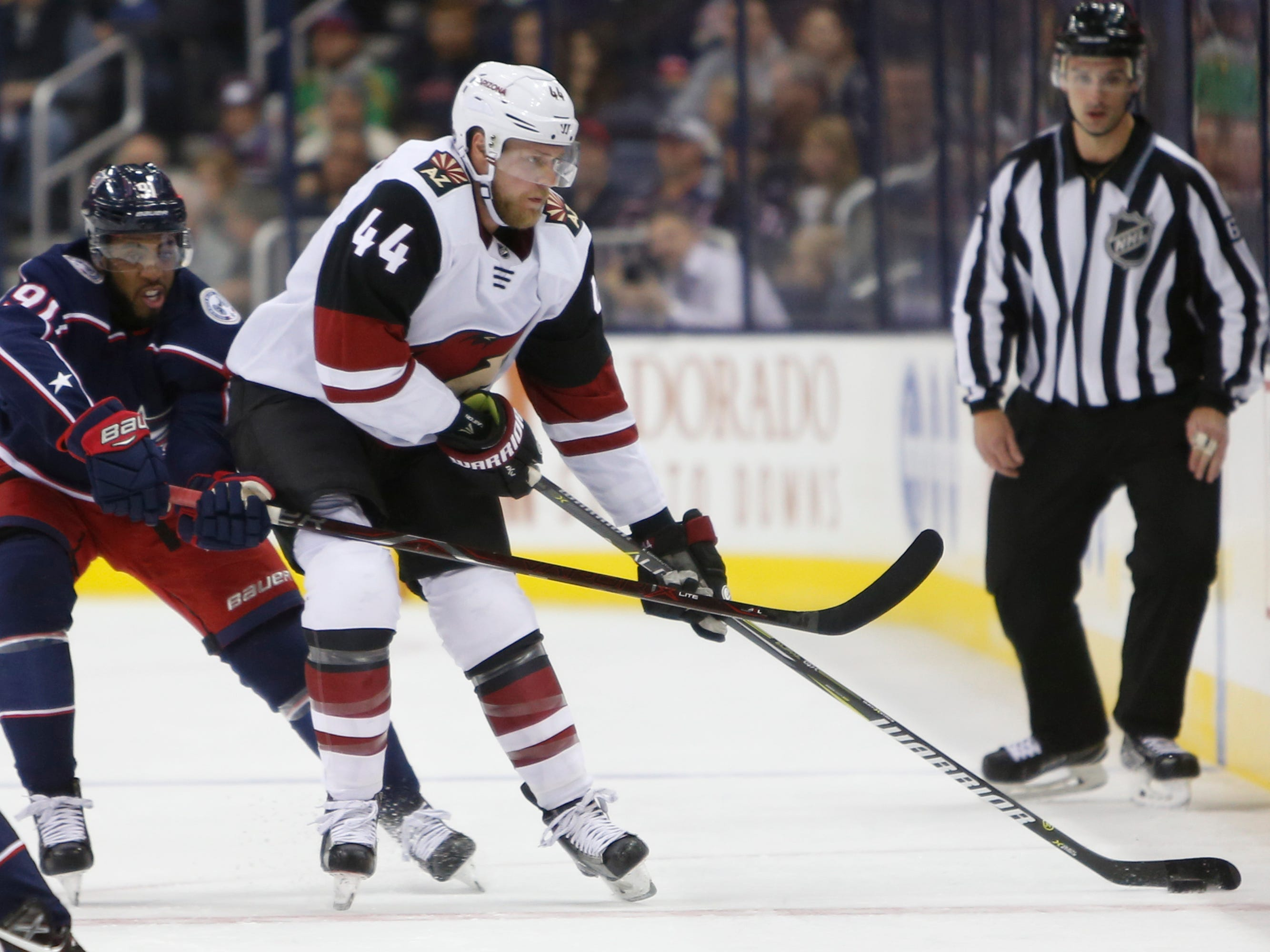 Arizona Coyotes' Kevin Connauton, right, carries the puck up ice as Columbus Blue Jackets' Anthony Duclair defends during the first period of an NHL hockey game Tuesday, Oct. 23, 2018, in Columbus, Ohio.