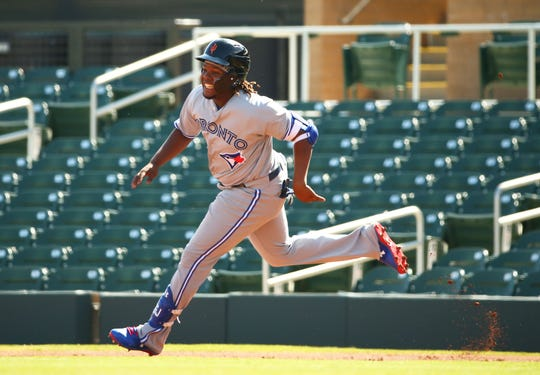 Surprise Saguaros Vladimir Guerrero Jr. hits an RBI-double against the Salt River Rafters in the first inning during a game Oct. 23 at Salt River Fields at Talking Stick.