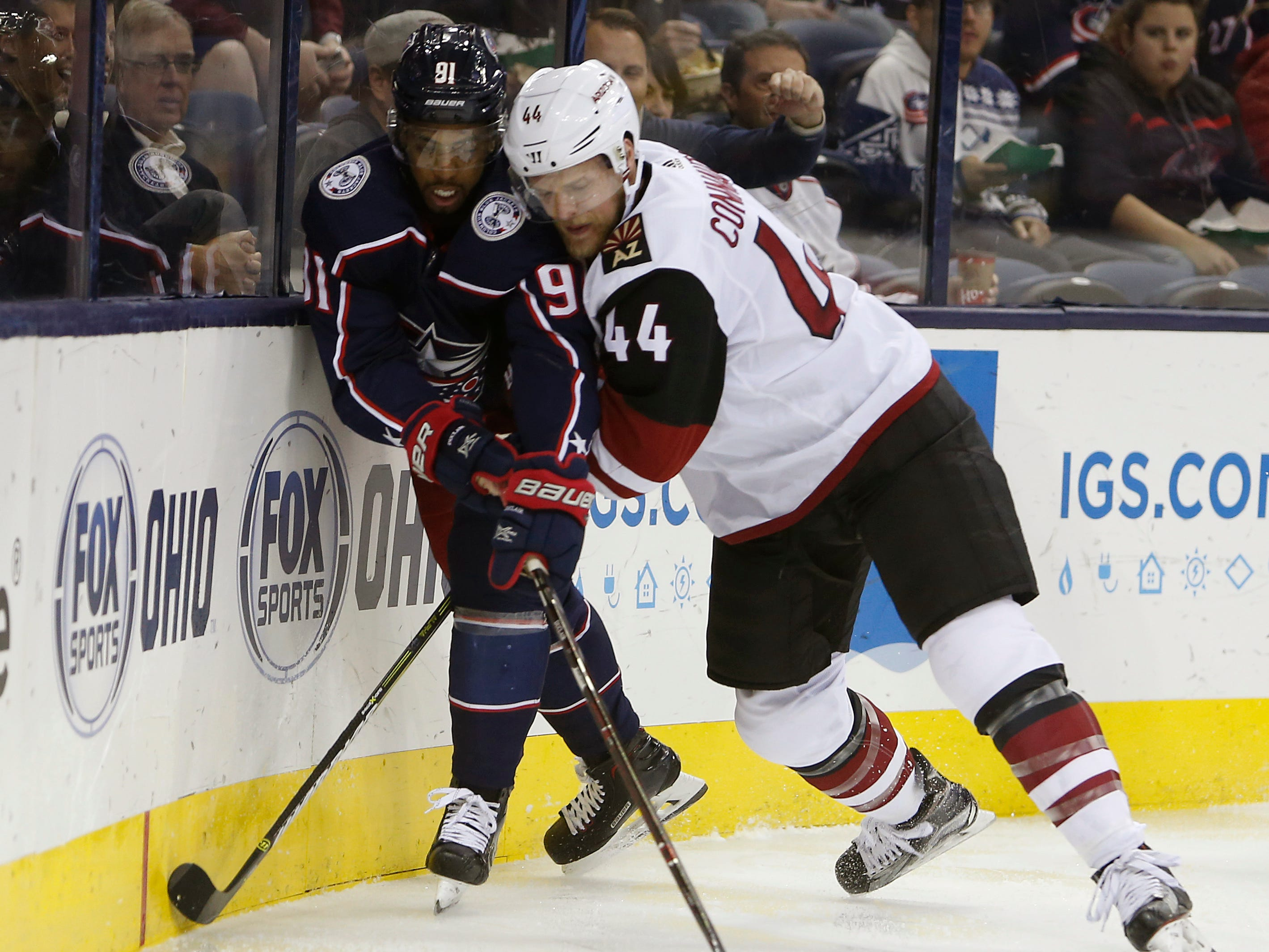 Arizona Coyotes' Kevin Connauton, right, checks Columbus Blue Jackets' Anthony Duclair during the second period of an NHL hockey game, Tuesday, Oct. 23, 2018, in Columbus, Ohio.