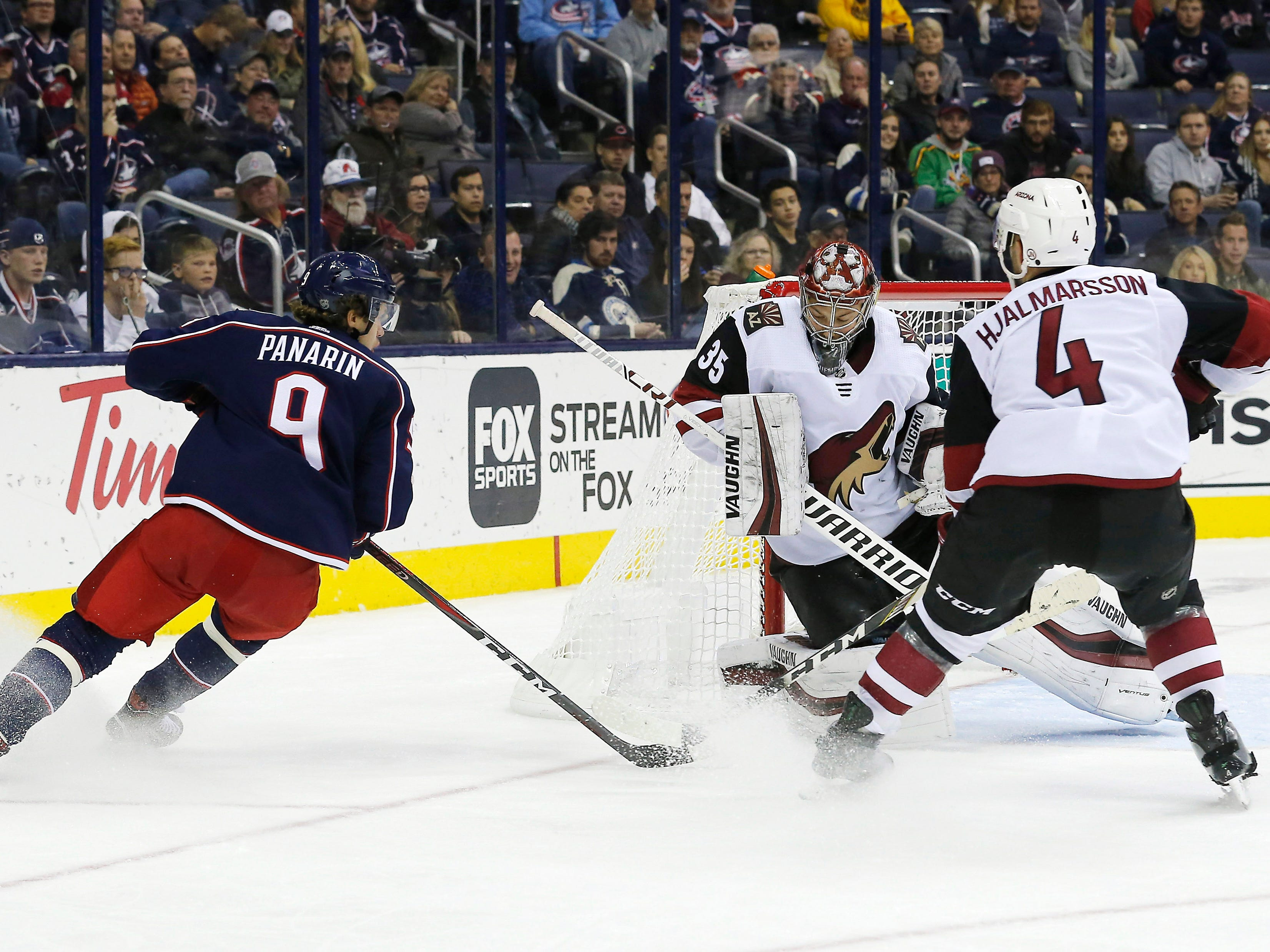 Oct 23, 2018; Columbus, OH, USA; Arizona Coyotes goalie Darcy Kuemper (35) makes a save against Columbus Blue Jackets left wing Artemi Panarin (9) during the third period at Nationwide Arena. Mandatory Credit: Russell LaBounty-USA TODAY Sports