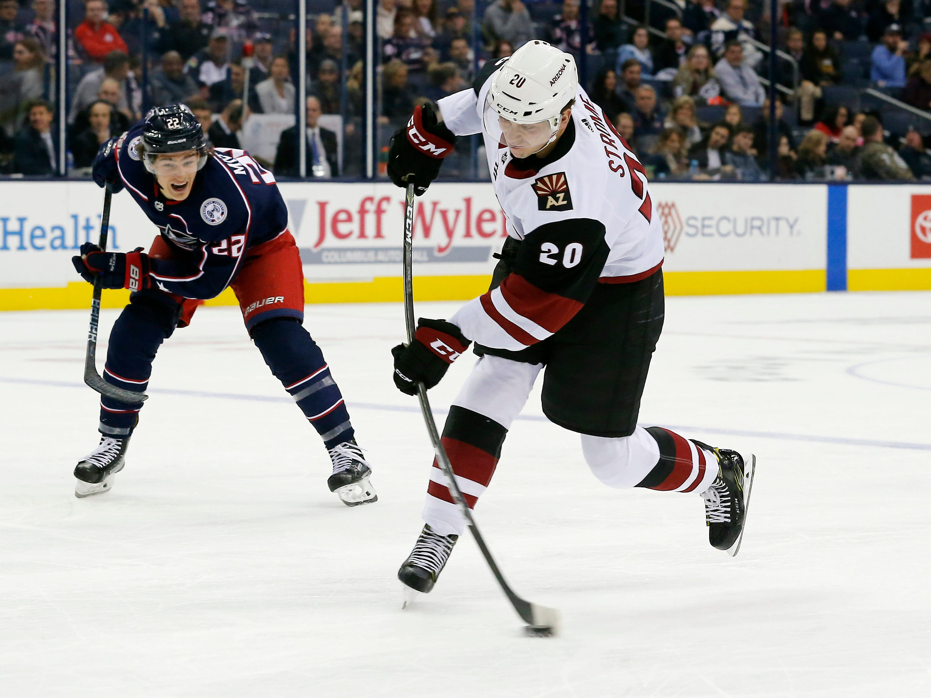 Oct 23, 2018; Columbus, OH, USA; Arizona Coyotes center Dylan Strome (20) attempts a shot on goal against the Columbus Blue Jackets during the second period at Nationwide Arena.