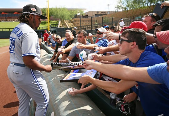 Surprise Saguaros Vladimir Guerrero Jr. signs autographs before during a game Oct. 23 at Salt River Fields at Talking Stick.