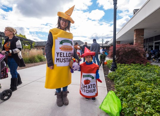 Jessica Dawson and her son Westley, 3, dressed as ketchup and mustard to attend St. Clair's Party for Tots Wednesday, Oct. 24, 2018 at Riverview Plaza.