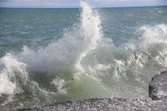 A wave slams into the breakwater at Port Sanilac.