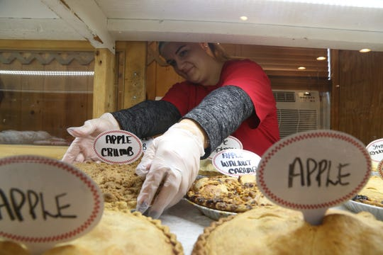Barton Orchards farm stand and bakery head baker Cindy Murray restocks the pies in the bakery's display case on October 24, 2018.