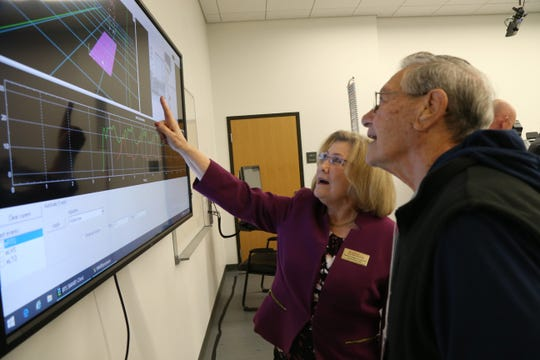 Claudia Fenderson, chair of Marist College's physical therapy department, explains what is displayed on a monitor at the Movement Analysis Laboratory for Teaching and Research to Joe Lombardi, a volunteer in Marist's Center for Lifetime Study.