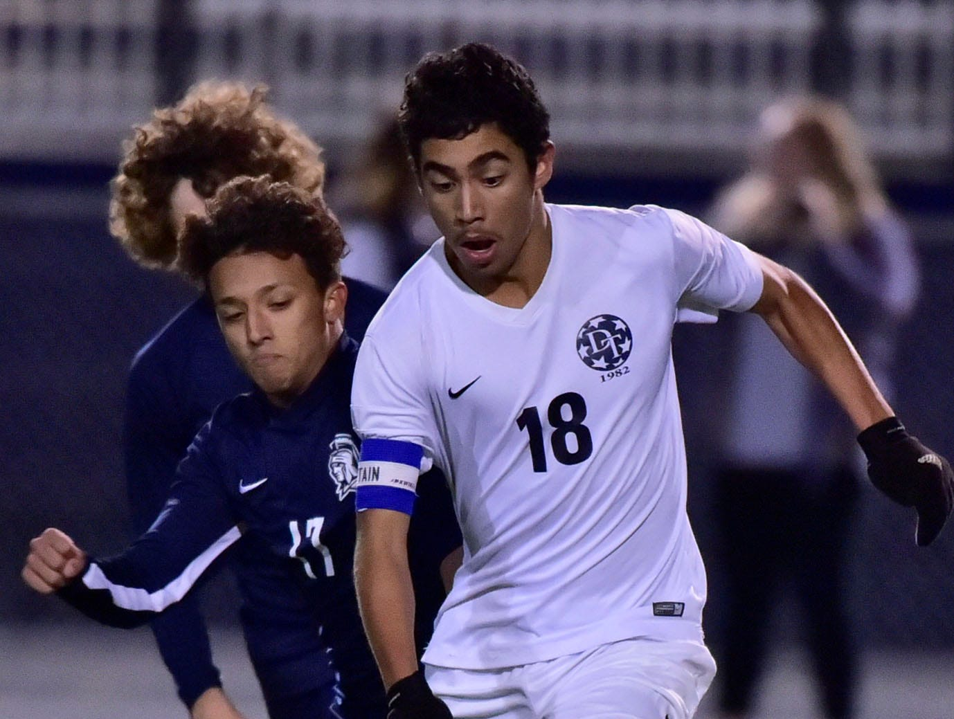 Dallastown's Leo Garcia (18) dribbles the ball ahead of Chambersburg's Chuy Munoz. Chambersburg lost a first round D3 soccer match to Dallastown 2-1 on Tuesday, Oct. 23, 2018.