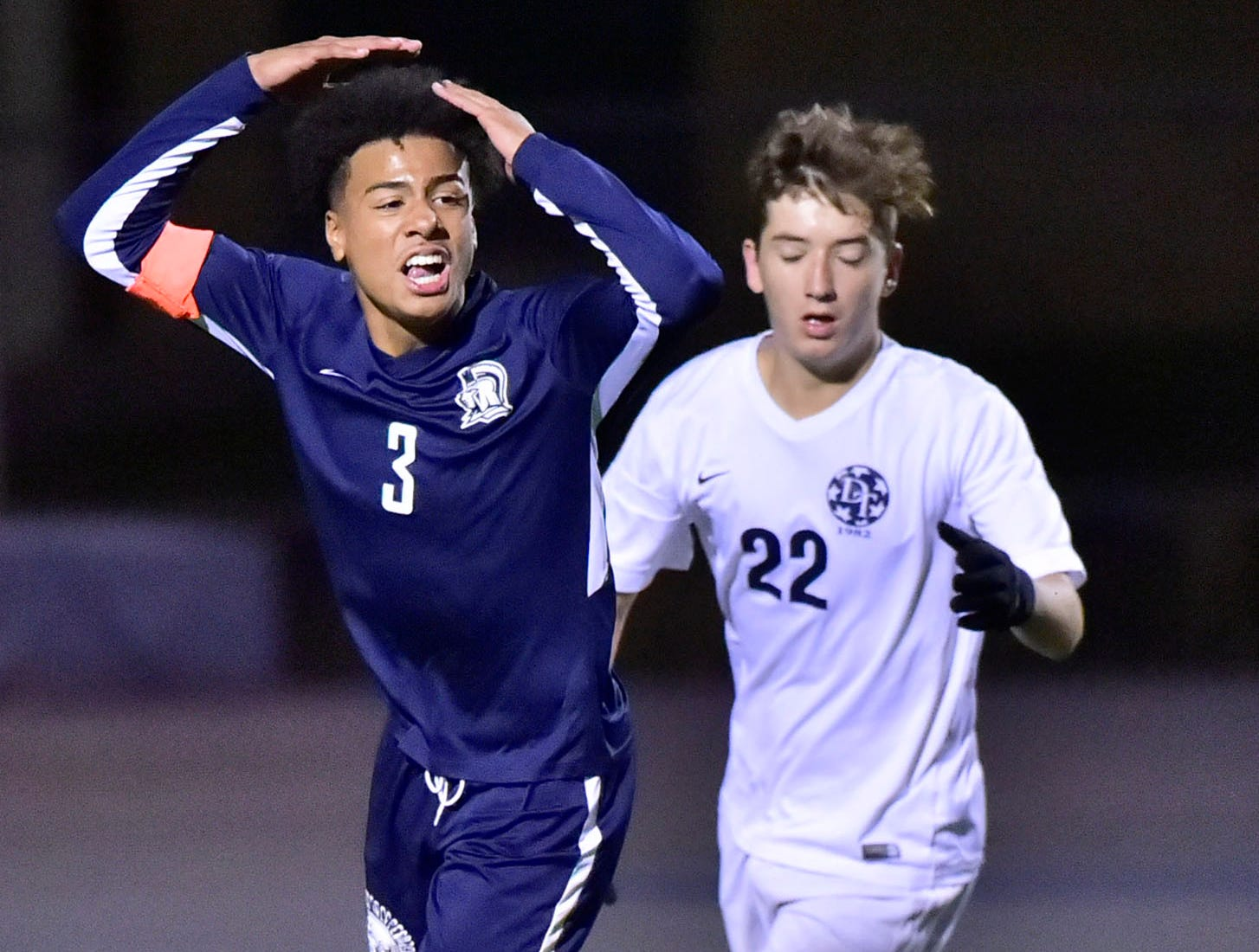 Ebe Hewitt (3) of Chambersburg reacts to a goal shot that went wide as Joe Thomas (22) moves in for Dallastown. Chambersburg lost a first round D3 soccer match to Dallastown 2-1 on Tuesday, Oct. 23, 2018.