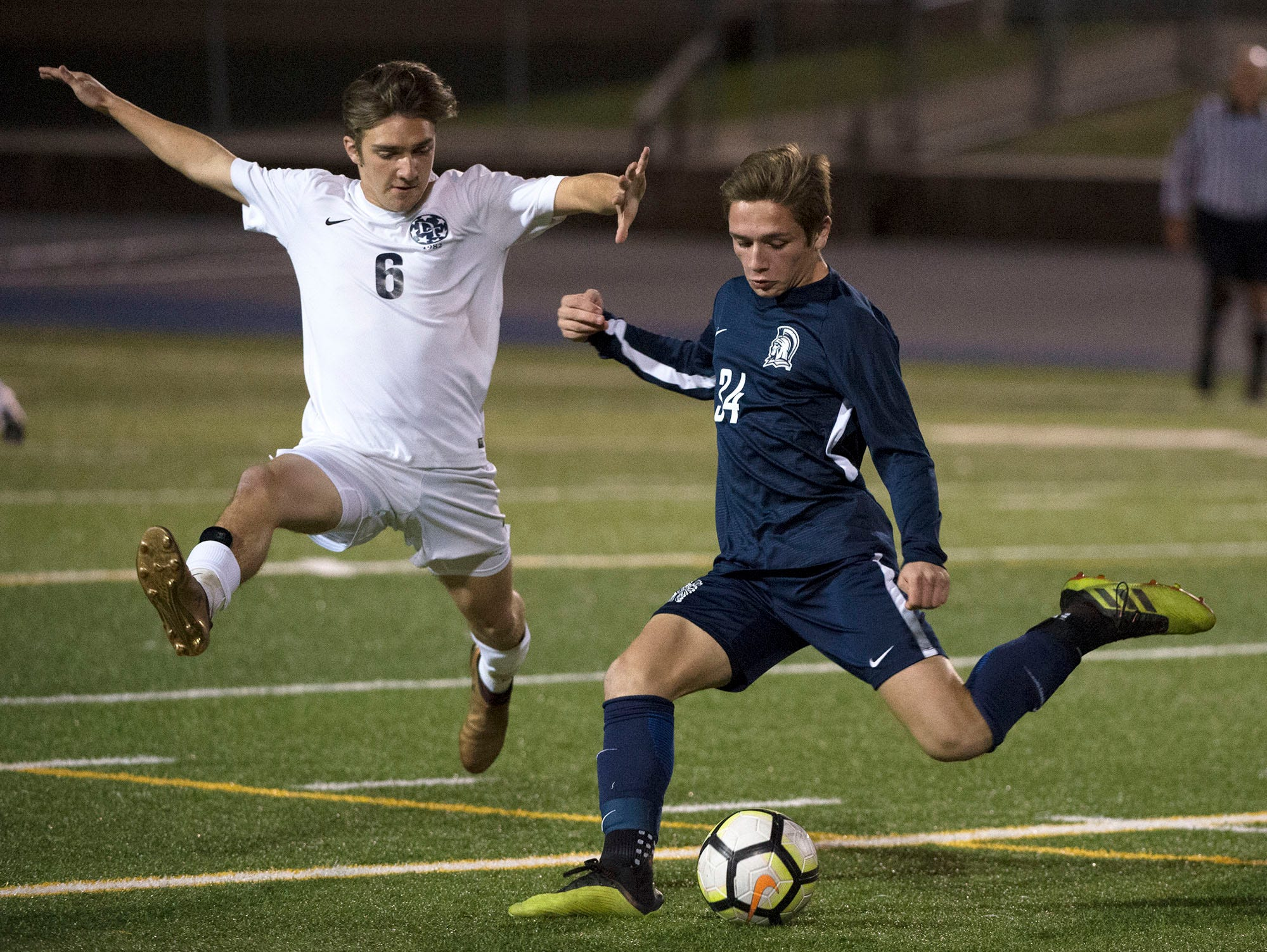 Chambersburg's Garrick Hill (34) kicks the ball around Carmen Ridolfi (6) of Dallastown. Chambersburg lost a first round D3 soccer match to Dallastown 2-1 on Tuesday, Oct. 23, 2018.