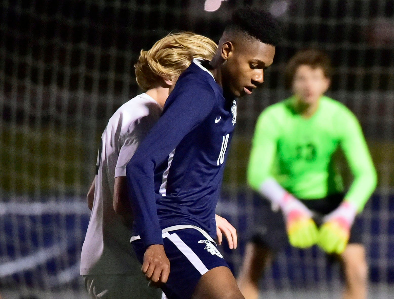 Omario Duncan (10) of Chambersburg moves the ball for the Trojans. Chambersburg lost a first round D3 soccer match to Dallastown 2-1 on Tuesday, Oct. 23, 2018.