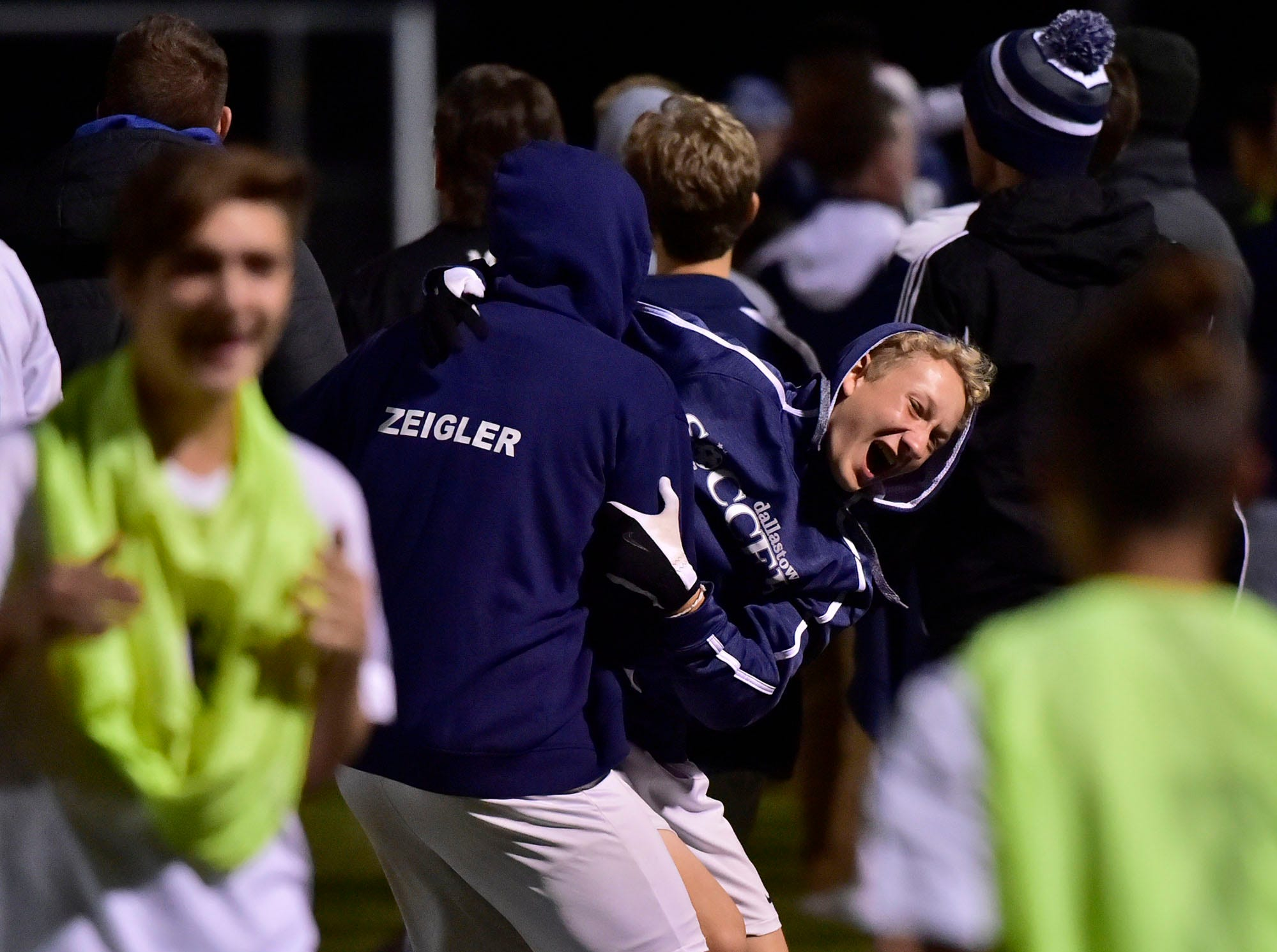 Chambersburg teammates celebrate after a score. Chambersburg lost a first round D3 soccer match to Dallastown 2-1 on Tuesday, Oct. 23, 2018.