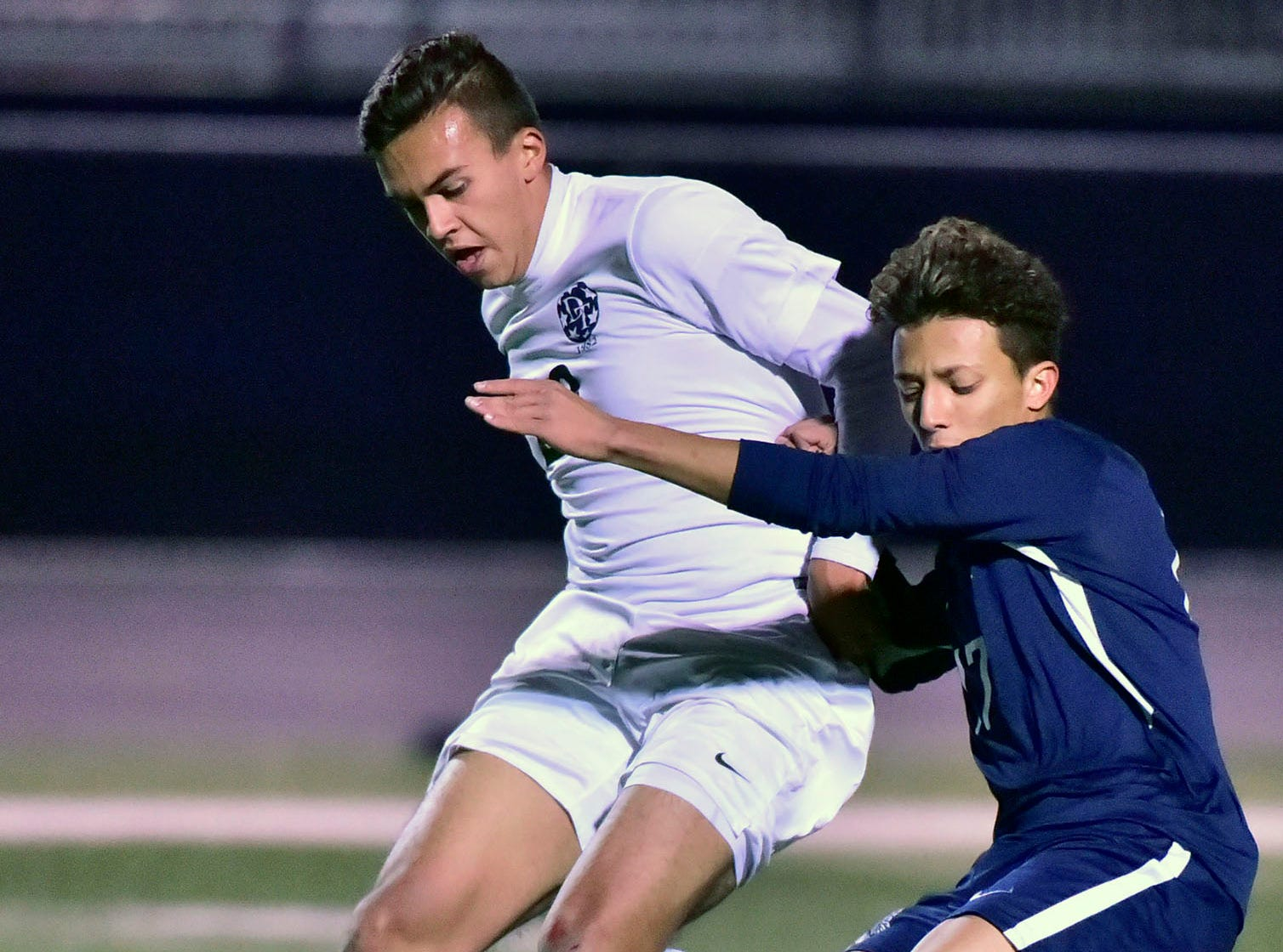 Gabe Wunderlich, left, of Dallastown, tries to move the ball around Chambersburg's Chuy Munoz. Chambersburg lost a first round D3 soccer match to Dallastown 2-1 on Tuesday, Oct. 23, 2018.