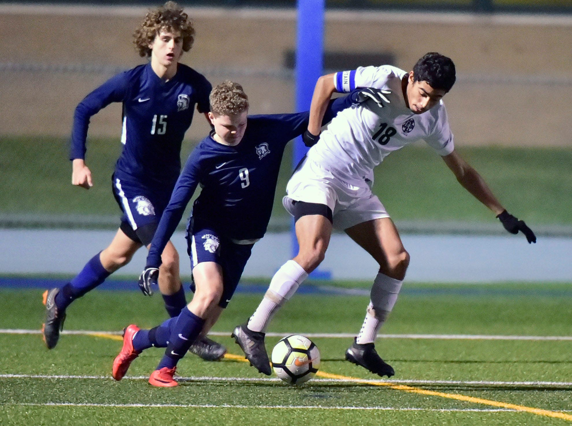Dallastown's Leo Garcia (18) controls the ball ahead of Chambersburg Aaron Maynard (15) and Luke Mason (9). Chambersburg lost a first round D3 soccer match to Dallastown 2-1 on Tuesday, Oct. 23, 2018.
