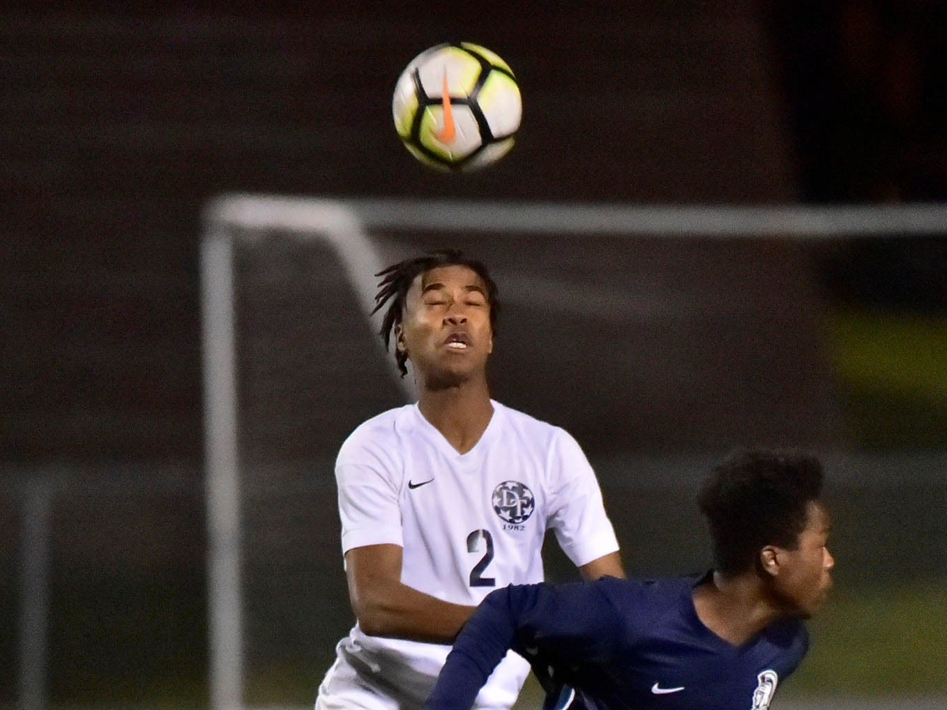Jaiden Lisbon (2) of Dallastown heads the ball in front of Terrell Samuels of Chambersburg. Chambersburg lost a first round D3 soccer match to Dallastown 2-1 on Tuesday, Oct. 23, 2018.