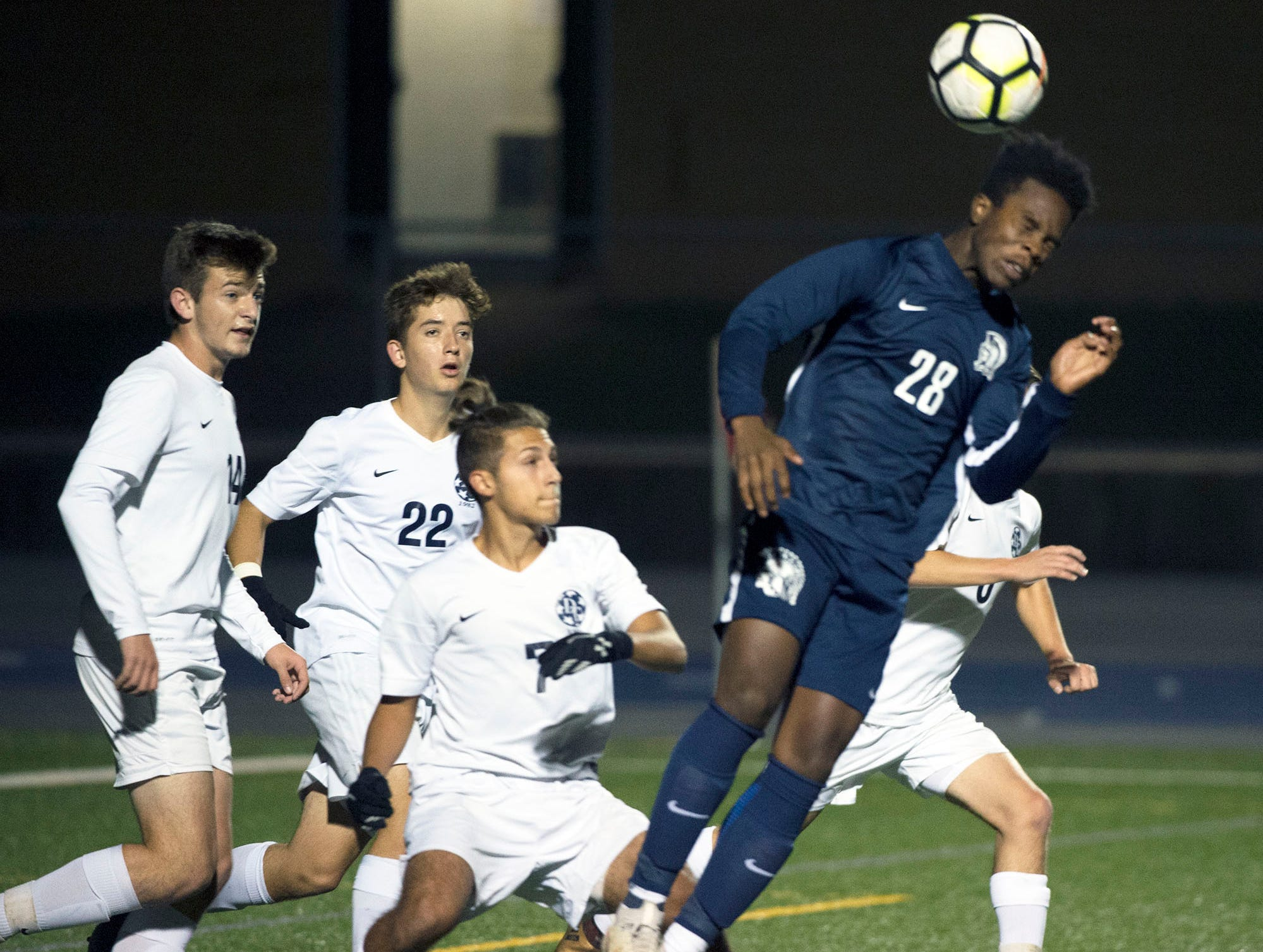 Terrell Samuels (28) heads the ball for Chambersburg. Chambersburg lost a first round D3 soccer match to Dallastown 2-1 on Tuesday, Oct. 23, 2018.