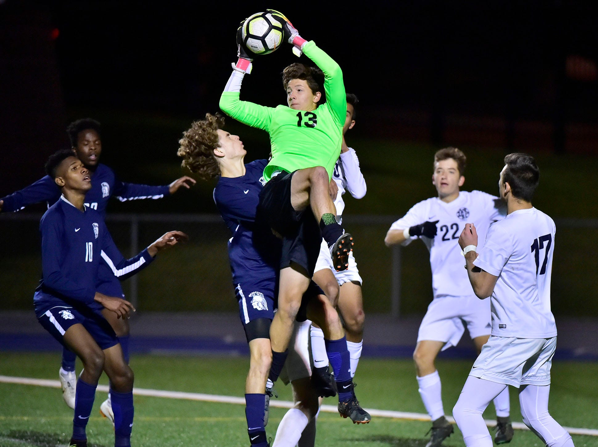 Keeper Gavin Conners (13) leaps to save the ball. Chambersburg lost a first round D3 soccer match to Dallastown 2-1 on Tuesday, Oct. 23, 2018.
