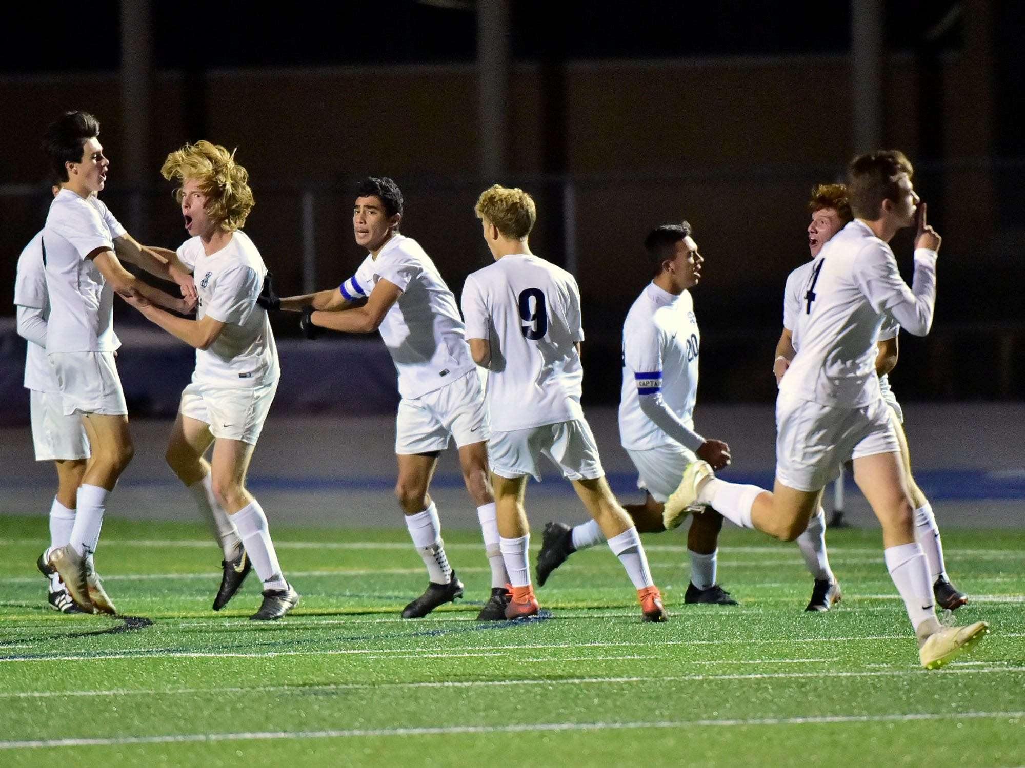 Dallastown teammates celebrate a score. Chambersburg lost a first round D3 soccer match to Dallastown 2-1 on Tuesday, Oct. 23, 2018.