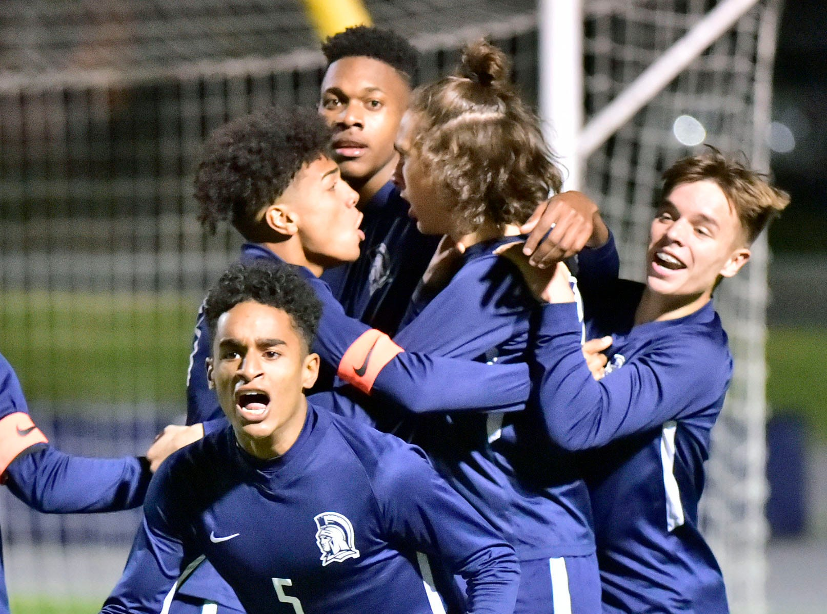 Chambersburg teammates celebrate a second half score to tie the game. Chambersburg lost a first round D3 soccer match to Dallastown 2-1 on Tuesday, Oct. 23, 2018.