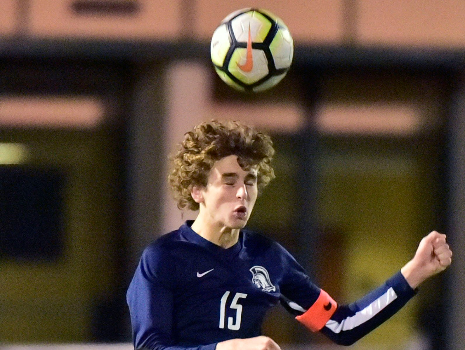 Aaron Maynard of Chambersburg heads the ball over Dallastown's Keegan Lambertson. Chambersburg lost a first round D3 soccer match to Dallastown 2-1 on Tuesday, Oct. 23, 2018.