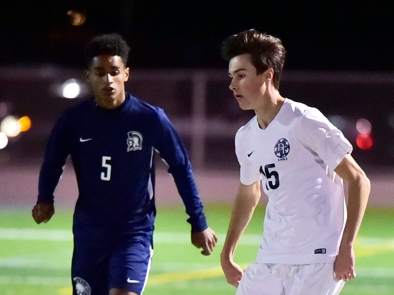 Mike Shirey (15) of Dallastown controls the ball in front of Chamberbsurg's Mikey Williams. Chambersburg lost a first round D3 soccer match to Dallastown 2-1 on Tuesday, Oct. 23, 2018.