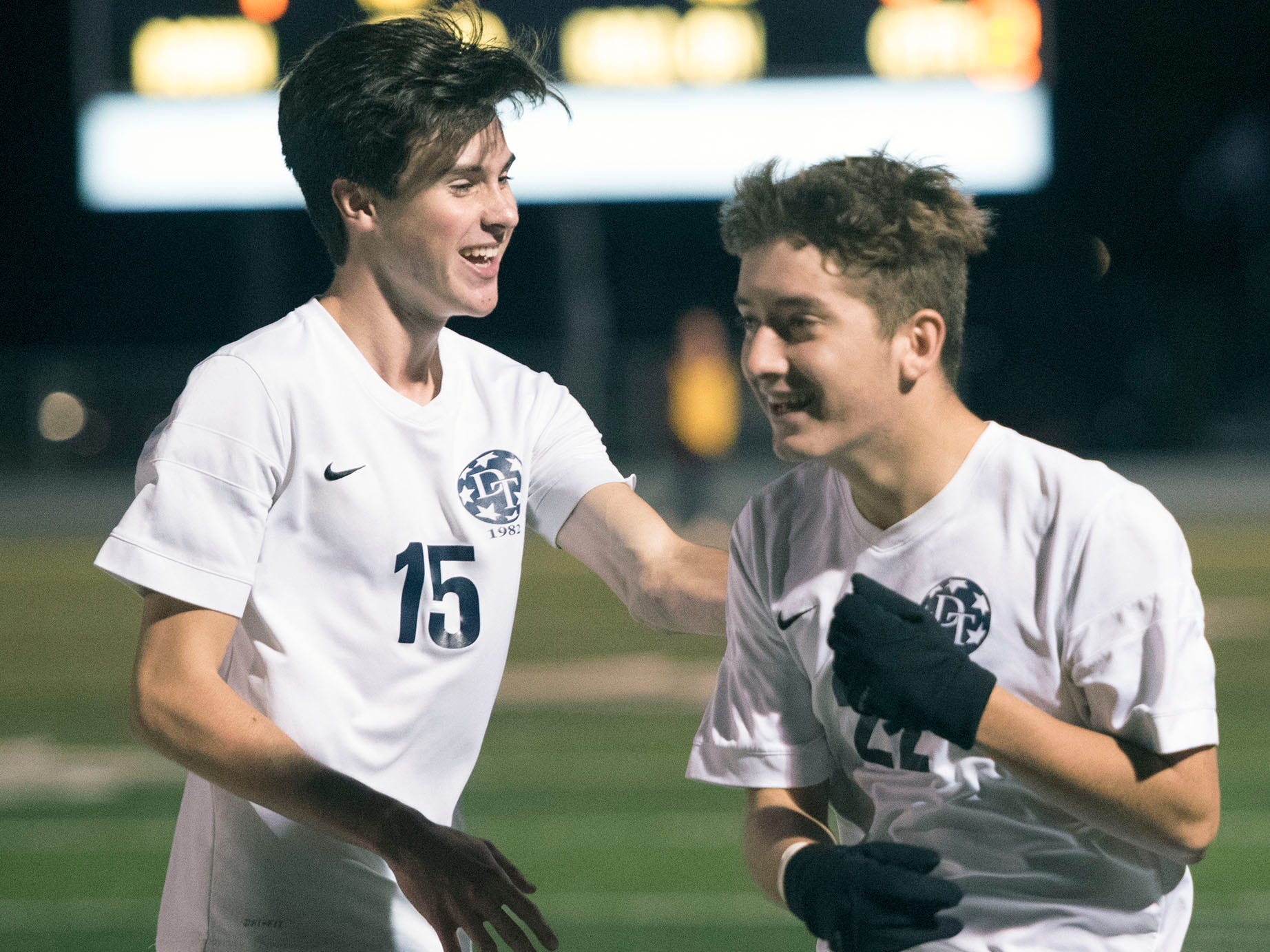 Dallastown teammates Mike Shirey (15) and Joe Thomas (22) celebrate a victory over Chambersburg. Chambersburg lost a first round D3 soccer match to Dallastown 2-1 on Tuesday, Oct. 23, 2018.