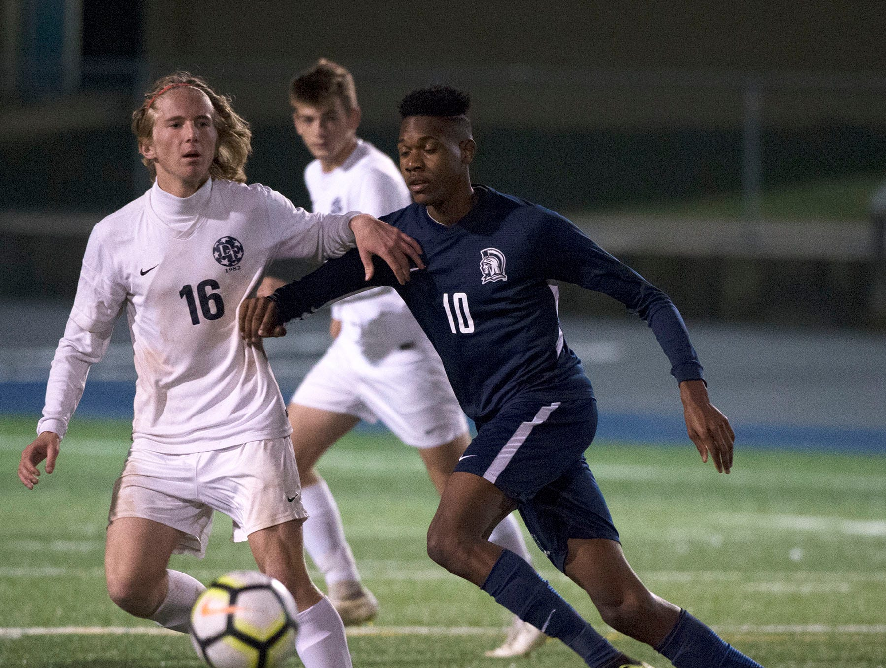 Dallastown's Cole Larson (16) challenges of Chambersburg's Omario Duncan (10) for the ball. Chambersburg lost a first round D3 soccer match to Dallastown 2-1 on Tuesday, Oct. 23, 2018.
